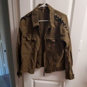 Green jacket with black lace up on sleeves
